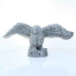 Сова полярная с расправленными крыльями